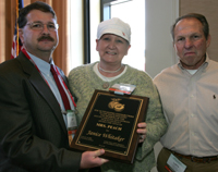 Jeff Wainwright, (left) of the GA Peach Council and Larry Yonce (right) representing the SC Peach Council present Janice Whitaker (center) with the 2009 Mrs. Peach Award
