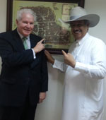 Saudi Cowboys - Parke Wright presents a Stetson cowboy hat to Abdullah Shuwaish, Manager at the King Faisal Center for Research and Islamic Studies