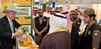 Parke Wright serves orange juice in his Fresh From Florida exhibit at the Saudi Agro Food Exhibition September 2012
