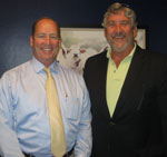 Congressman Ted Yoho (left) and Gary Cooper. Note the painting of Florida cattle on Yoho's Washington D. C. office wall in the background!